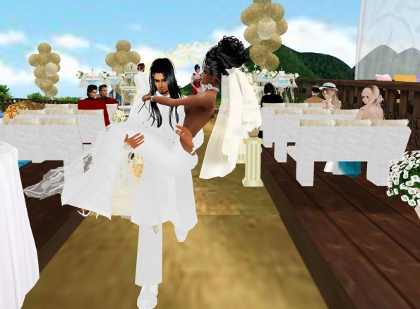 MRSLOLABITESME AND MRVINCENTBITESME_WEDDING PIC_CARRYING THE BRIDE AWAY